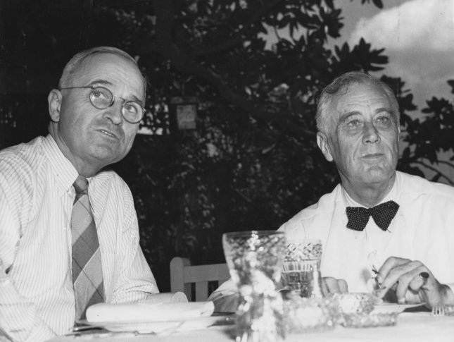 U.S. President Franklin Delano Roosevelt (R) is shown at lunch on the White House lawn Aug. 21, 1944, with vice presidential running mate Harry S. Truman. Roosevelt was elected to a fourth term on Nov. 7. (UPI Photo/Files)