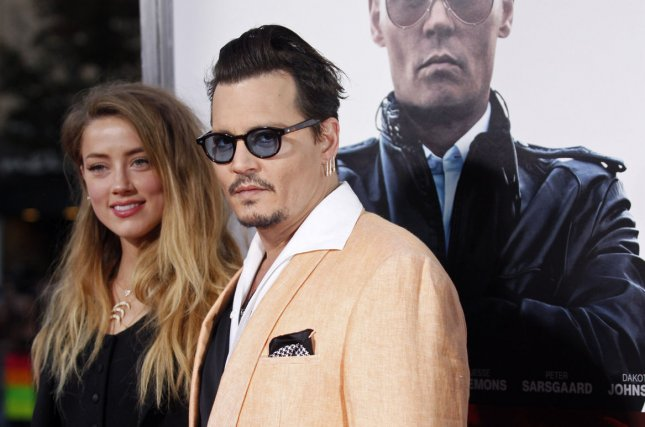 Johnny Depp (R) and wife Amber Heard at a special screening of 'Black Mass' in Brookline, Mass., on Sept.15, 2015. Photo by Matthew Healey/UPI