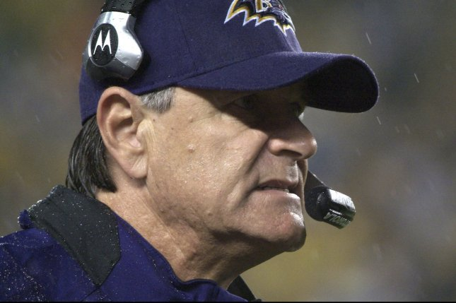Former Baltimore Raven head coach Brian Billick grimaces as he watches the Ravens in the pouring rain of the first quarter against the Pittsburgh Steelers at Heinz Field in Pittsburgh on November 5, 2007. (UPI Photo/Archie Carpenter)
