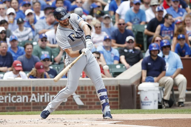 Tampa Bay Rays Evan Longoria hits an RBI single off Chicago Cubs starting pitcher John Lackey in the first inning at Wrigley Field on July 5, 2017 in Chicago. File photo by Kamil Krzaczynski/UPI