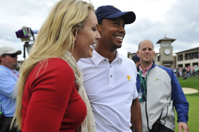 United States team member Tiger Woods (R) and former girlfriend Lindsey Vonn smile as they stand on the 18th green after Woods won his match against International Team member Richard Sterne of South Africa to clinch a U.S. victory during the fifth round singles competition at the 2013 Presidents Cup at Muirfield Village Golf Club in Dublin, Ohio. File photo by Brian Kersey/UPI