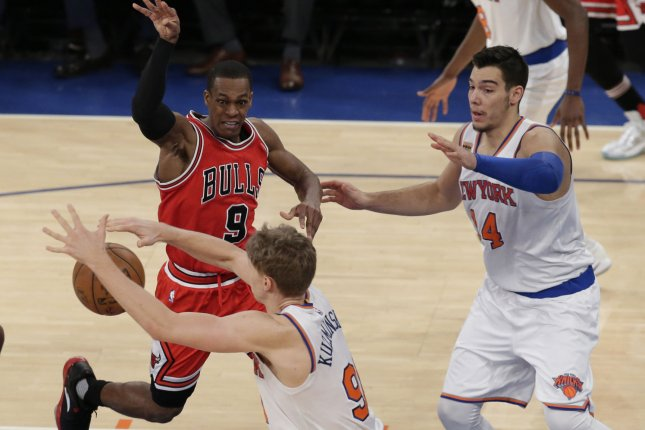New York Knicks' Willy Hernangomez watches Mindausgas Kuzminskas intercept a pass from former Chicago Bulls point guard Rajon Rondo. File photo by John Angelillo/UPI