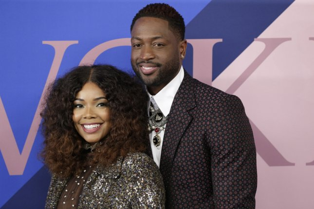 Gabrielle Union (L) and Dwyane Wade gave Oprah Winfrey an intimate glimpse into their life at home with daughter Kaavia. File Photo by John Angelillo/UPI