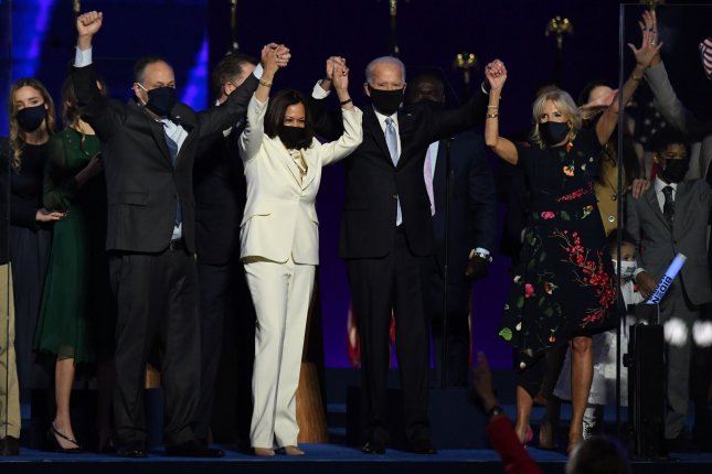 President-elect Joe Biden (2nd R), his wife, Jill Biden (R), Vice President-elect Kamala Harris (2nd L) and her husband, Douglas Emhoff, appear onstage Saturday night with their families in Delaware. Photo by Pat Benic/UPI