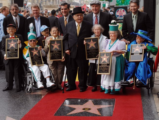 Honorary Mayor of Hollywood, Johnny Grant, center with black hat, honors The Munchkins from The Wizard of Oz as they receive a star on the Hollywood Walk of Fame in Los Angeles on November 20, 2007. The Munchkins from left: Mickey Carroll, the Town Crier; Clarence Swensen, a Munchkin soldier, Jerry Maren, part of the Lollipop Guild; Karl Slover, the Main Trumpeter; Ruth Duccini, a Munchkin villager; Margaret Pelligrini, the 'sleepyhead' Munchkin and Meinhardt Raabe, the coroner. Back row from left: Ted Bulthaup, star sponsor and owner of a Trip to the Movies Theatre in Chicago, Hollywood Chamber Chairman Jeff Briggs, Los Angeles City Council President Eric Garcetti, Johnny Grant, Tom LaBonge, Los Angeles Councilman, and Leron Gubler, Chamber President & CEO. (UPI Photo/Jim Ruymen).