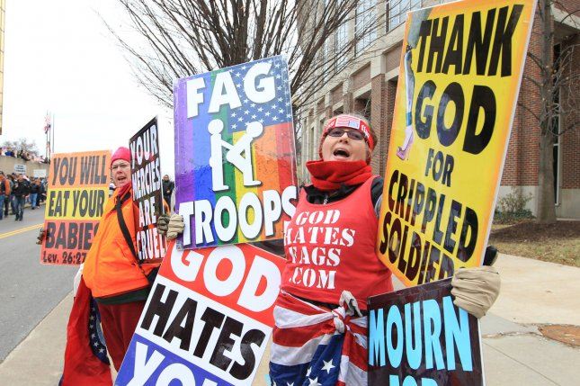 Two members from the Westboro Baptist Church of Topeka, Kansas, begin their chants on a street corner in St. Charles, Missouri as those disagreeing with their views, walk down the street to greet them on January 6, 2011. (File/UPI/Bill Greenblatt)