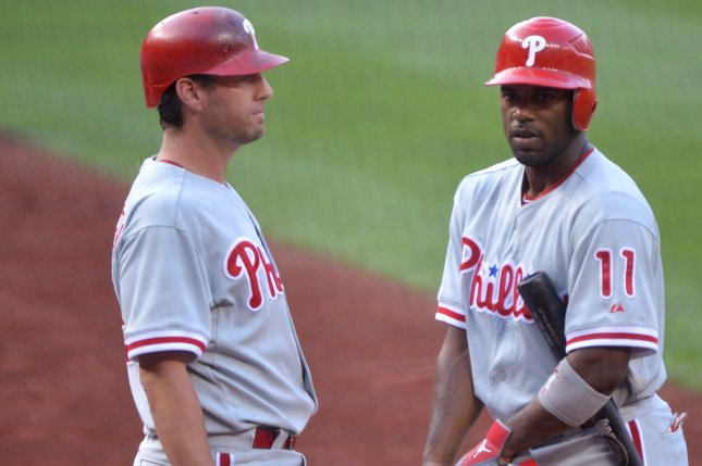 Philadelphia Phillies Chase Utley and Jimmy Rollins talk prior to their game against the Washington Nationals at Nationals Park in Washington, D.C. on August 2, 2012. UPI/Kevin Dietsch