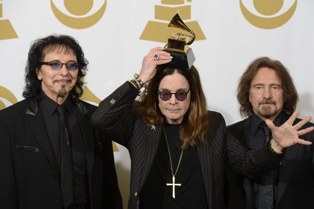 (L-R) Recording artists Tony Iommi, Ozzy Osbourne and Geezer Butler of Black Sabbath hold their Grammy Award for Best Metal Performance for the song 'God is Dead?' at the 56th annual Grammy Awards at Staples Center in Los Angeles on Jan. 26, 2014. File Photo by UPI/Phil McCarten