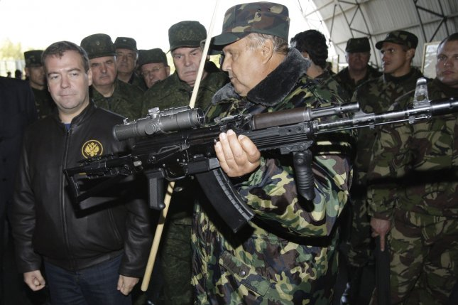 Kalashnikov is planning to expand sales to civilian markets as Western sanctions pressure the company. Pictured, former Russian President Dmitry Medvedev (L) looks at a Kalashnikov automatic weapon during Russian-Belarus joint military exercises on September 29, 2009. File photo by Anatoli Zhdanov/UPI