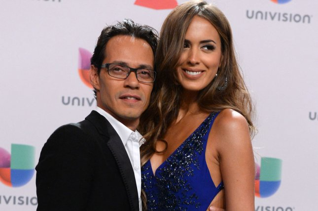 Singer Marc Anthony (L) and model Shannon de Lima arrive for the 15th annual Latin Grammy Awards on November 20, 2014. The couple are getting divorced. File Photo by Jim Ruymen/UPI