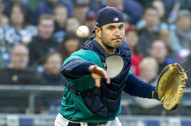 Seattle Mariners' catcher David Freitas throws out Los Angeles Angels batter Andrelton Simmons in the second inning on May 4 at Safeco Field in Seattle, Wash. Photo by Jim Bryant/UPI