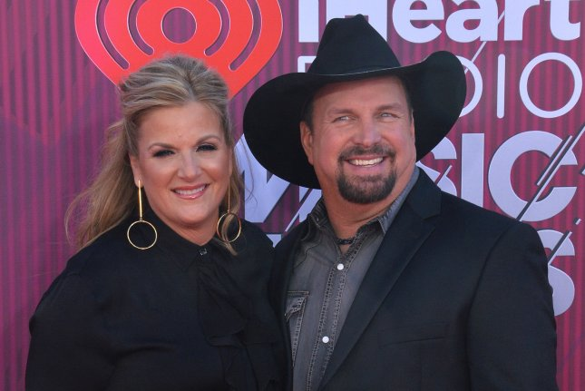 Trisha Yearwood (L), pictured with Garth Brooks, shared the track list for her album Every Girl and a video for the lead single, Every Girl in This Town. File Photo by Jim Ruymen/UPI