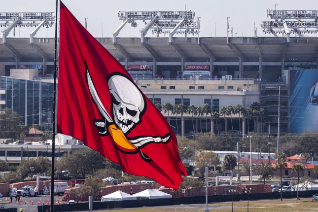 A Tampa Bay Buccaneers flag flies in front of Raymond James Stadium ahead of Super Bowl LV in Tampa, Fla. on Thursday. Photo by Kevin Dietsch/UPI