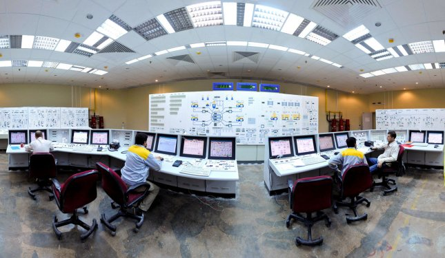 Interior view of Iranian and foreign technicians work at Iran's Bushehr Nuclear power plant, 755 miles south of the capital Tehran,Iran, in photo released on November 30,2009. Iran announced plans to build ten uranium-enrichment plants, drawing sharp international criticism and fueling fears the country wants to build a nuclear weapon. UPI/ISNA/Mehdi Ghasemi