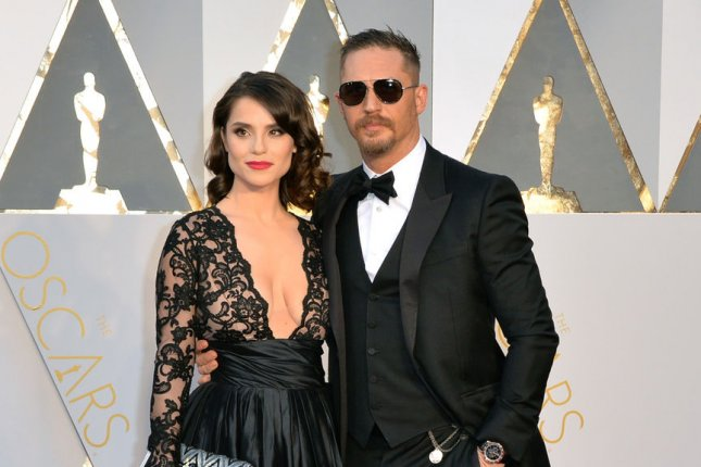 Charlotte Riley and Tom Hardy (R) arrive on the red carpet during the 88th Academy Awards on February 28, 2016. Hardy stars in the upcoming FX supernatural thriller, Taboo, which premieres in early 2017. File Photo by Kevin Dietsch/UPI