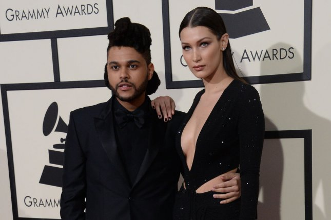 The Weeknd and Bella Hadid arrive for the 58th annual Grammy Awards on February 15. The couple have ended their relationship after a year and a half of dating. File Photo by Jim Ruymen/UPI