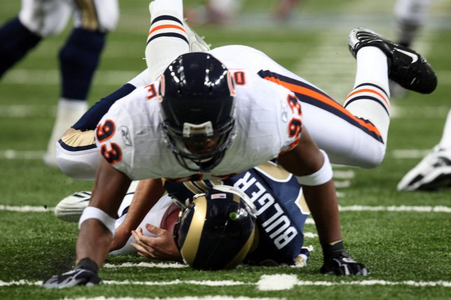 Chicago Bears' Adewale Ogunleye (93) smashes St. Louis Rams quarterback Marc Bulger to the ground for a sack in St. Louis on November 23, 2008. Bulger left the game with a concussion. File photo by Bill Greenblatt