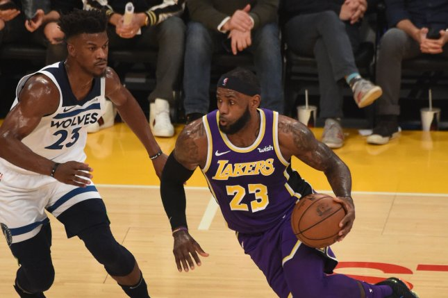 Los Angeles Lakers star LeBron James (R) drives to the basket while defended by Minnesota Timberwolves star Jimmy Butler in the first quarter on Wednesday at Staples Center in Los Angeles. Photo by Jon SooHoo/UPI