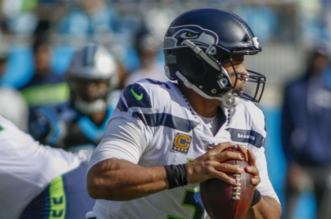 Seattle Seahawks quarterback Russell Wilson (3) looks to pass against the Carolina Panthers in the first half on Sunday in Charlotte, North Carolina. Photo by Nell Redmond/UPI