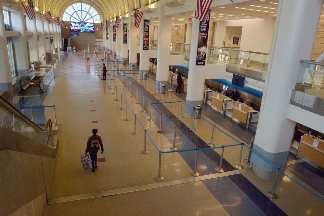 The American Airlines terminal sits empty early evening at Los Angeles International on April 19. American and four others Thursday signed letters of intent to receive loans from the federal CARES Act. Photo by Jim Ruymen/UPI