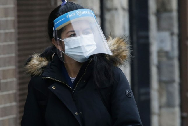Most Americans will continue COVID-19 control measures after the pandemic ends, according to a new poll. File Photo by John Angelillo/UPI
