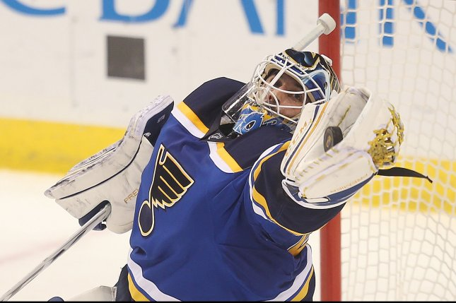 St. Louis Blues goaltender Carter Hutton snags a puck from the air from the Edmonton Oilers shot in the third period at the Scottrade Center in St. Louis on December 19, 2016. Edmonton won the game 3-2 in overtime. Photo by BIll Greenblatt/UPI