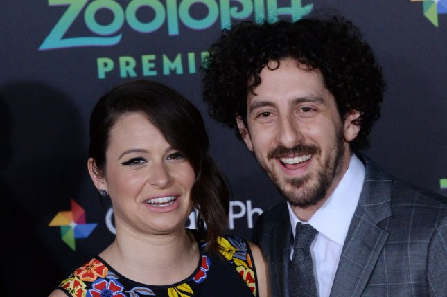 Katie Lowes (L) and Adam Shapiro attend the Los Angeles premiere of Zootopia on February 17. The actress announced Thursday that she's expecting a son with Shapiro. File Photo by Jim Ruymen/UPI