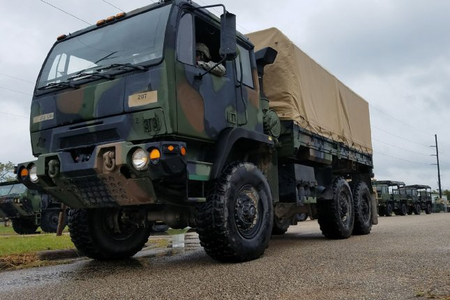 Members of the Texas National Guard prepare vehicles and rehearse water rescue training maneuvers Thursday in advance of Hurricane Harvey making landfall. Photo courtesy the Texas National Guard/UPI