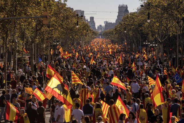 Spaniards show support for their central government during a pro-unity demonstration in Barcelona on October 29. Friday, former Catalan leader Carles Puigdemont renounced Madrid's moves as an attack on democracy. Photo by Xavi Herrero/ UPI