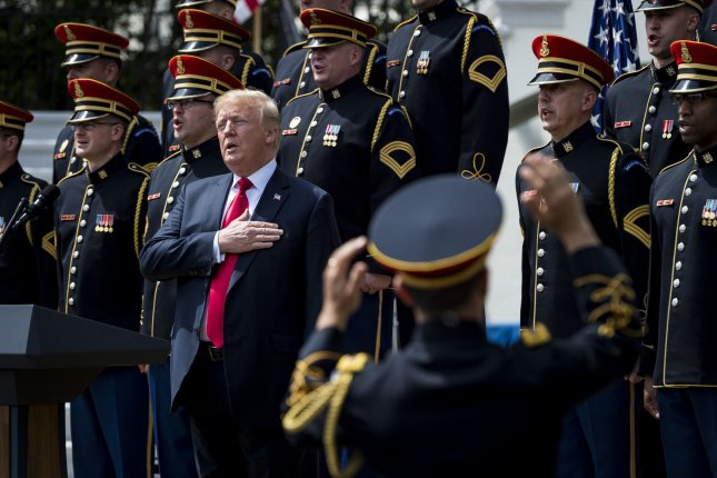 President Donald Trump sings the National Anthem during a Celebration of America event Tuesday on the South Lawn of the White House in Washington, D.C. The celebration is being staged as a replacement for a White House visit by the Super Bowl champion Philadelphia Eagles. Some of the team was planning on boycotting the event due to the President's stance on players kneeling during the National Anthem at NFL games, so Trump rescinded their invitation. Photo by Pete Marovich/UPI