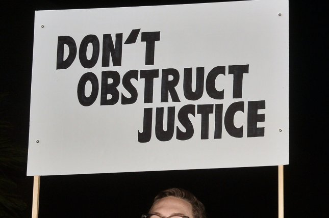 Activists voice support in Los Angeles November 8 for Special Counsel Robert Mueller after the departure of Attorney General Jeff Sessions. Photo by Jim Ruymen/UPI
