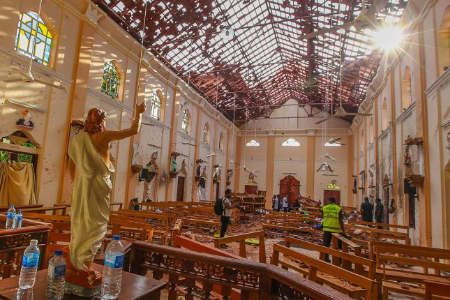 Sri Lankan soldiers work inside the St Sebastian's Church in Negombo, Sri Lanka, on Sunday after a bomb went off during an Easter service. Photo by Perera Sameera/UPI