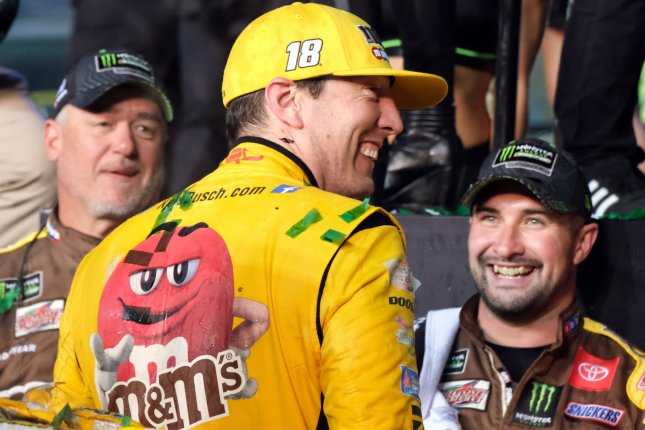 Kyle Busch (C), who won Monday's Xfinity Series race, has a goal to race in 7 events in 11 days. File Photo By Gary I Rothstein/UPI