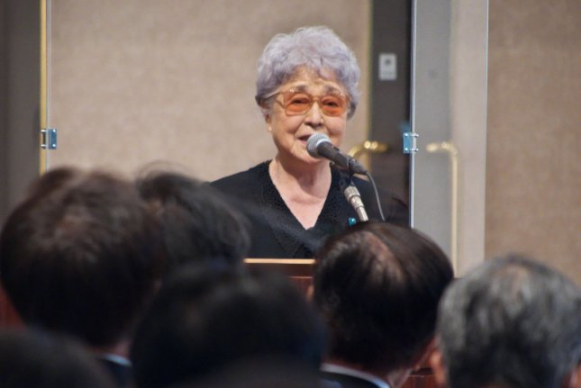 Sakie Yokota speaks during a farewell party for her husband, Shigeru Yokota, in Tokyo Saturday. Photo by Keizo Mori/UPI