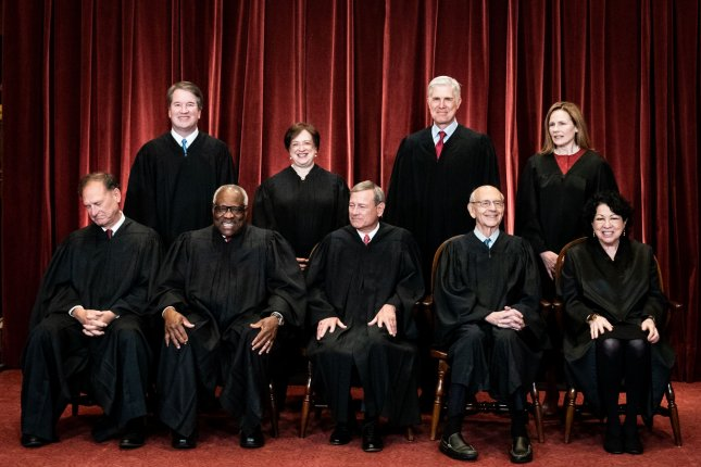 Members of the Supreme Court pose for a group photo on April 23. Seated, from left to right, are Associate Justices Samuel Alito and Clarence Thomas, Chief Justice John Roberts and Associate Justices Stephen Breyer and Sonia Sotomayor. Standing, from left to right, are Associate Justices Brett Kavanaugh, Elena Kagan, Neil Gorsuch and Amy Coney Barrett. File Pool Photo by Erin Schaff/UPI
