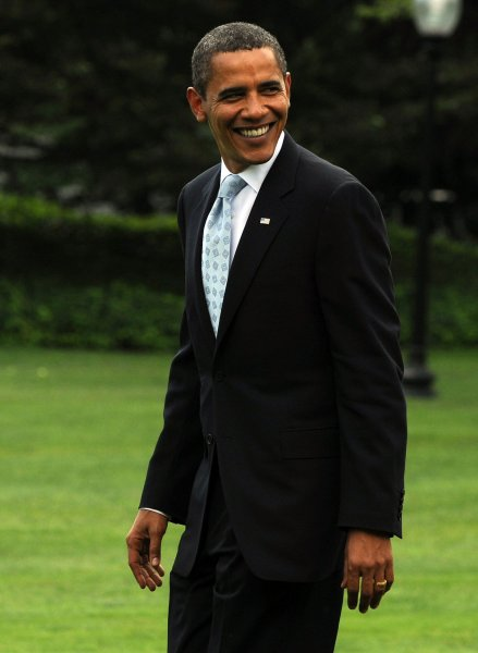 U.S. President Barack Obama smiles as he departs from the South Lawn of the White House en route to Camp David on August 21, 2009. (UPI/Roger L. Wollenberg)