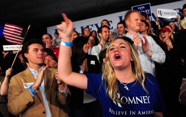 Audience members cheer during an election night rally for Republican Presidential candidate Mitt Romney in Columbia, South Carolina on January 21, 2012. Romney took second place to Newt Gingrich. UPI/Kevin Dietsch
