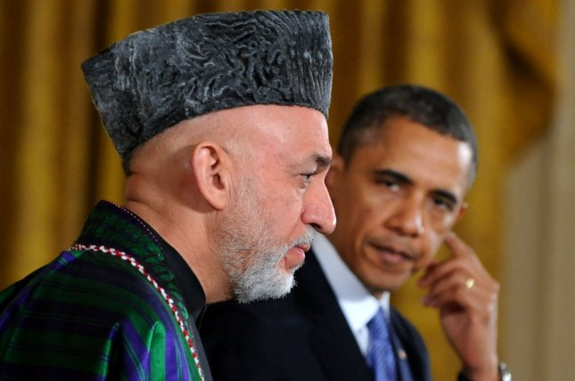 Obama tells Karzai U.S. will plan for 2014 withdrawal from Afghanistan