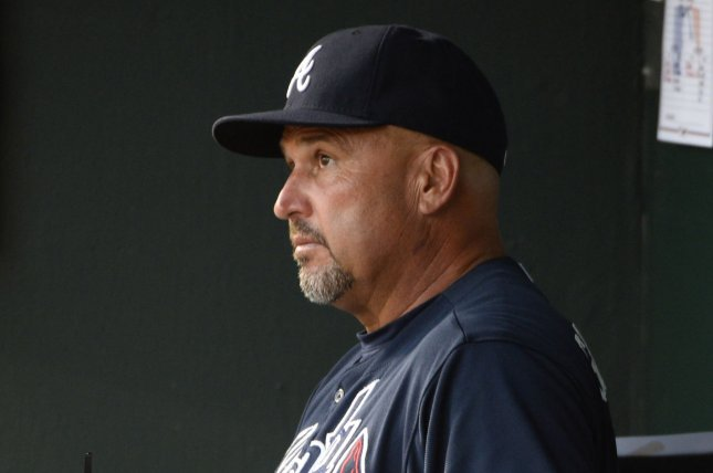 Atlanta Braves manager Fredi Gonzalez watches from the dugout. Photo by David Tulis/UPI