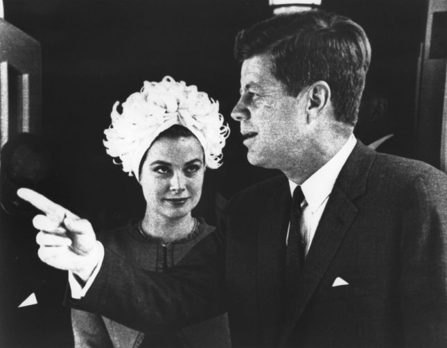 Grace Kelly, Monaco's princess and former film actress, locks eyes with President John F. Kennedy while visiting the White House in 1961. Photo by James Atherton/UPI