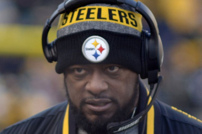 Pittsburgh Steelers head coach Mike Tomlin walks the sidelines late in the fourth quarter of the Pittsburgh Steelers 30-12 win over the Miami Dolphins on Sunday. Photo by Archie Carpenter/UPI