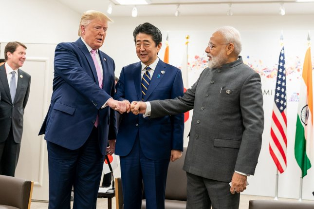 Japanese Prime Minister Shinzo Abe (C) and Indian Prime Minister Narendra Modi (R) have strengthened defense ties since 2015. The relationship has grown since U.S. President Donald Trump (L) assumed office. File Photo by  Shealah Craighead/White House