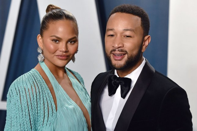 Chrissy Teigen (L), pictured with John Legend, weighed in on Kim Kardashian and Kanye West's split and discussed connecting with Meghan Markle on Watch What Happens Live. File Photo by Christine Chew/UPI