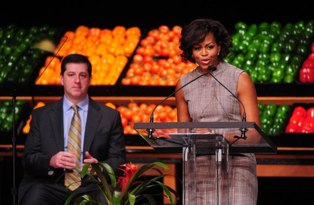 First Lady Michelle Obama speaks alongside Walmart CEO Bill Simon as she announces her support for Walmat's new health initiative in Washington on January 20, 2011. Walmart has announced they will cut the fat, sugar and sodium in some packaged foods and will lower the price of fresh fruits and vegetables. UPI/Kevin Dietsch