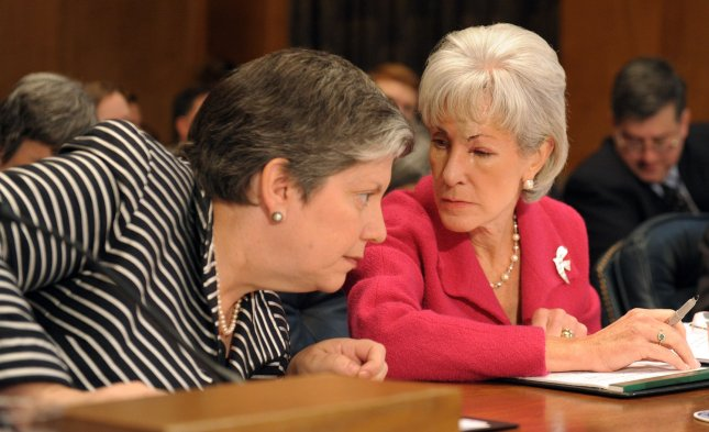 Secretary of Homeland Security Janet Napolitano speaks to Secretary of Health and Human Services Kathleen Sebelius (R) during a Senate Homeland Security and Governmental Affairs Committee hearing on the current H1N1 flu situation and the nation's response to the epidemic on Capitol Hill in Washington on October 21, 2009. UPI/Roger L. Wollenberg