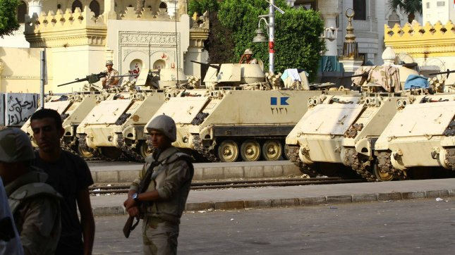 Egyptian Army armoured vehicles sit parked at a checkpoint in Cairo, Egypt, July 08, 2013. A Saudi activist alleges the Saudi government provided $1 billion to help oust President Morsi. UPI/Ahmed Jomaa