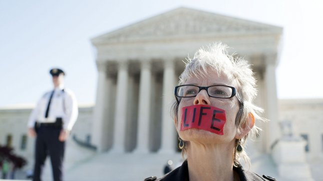 Lori Meyer, an anti-abortion protester with Bound 4 Life, protests in front of the U.S. Supreme Court as the court begins hearing arguments on the constitutionality of President Obama's health care bill in Washington, D.C. on March 26, 2012. UPI/Kevin Dietsch
