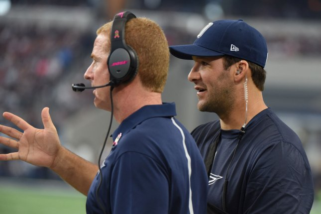 Dallas Cowboys Tony Romo, who is out with a shoulder injury, talks to head coach Jason Garrett during the first half at AT&T Stadium on October 11, 2015 in Arlington, Texas. Photo by Ian Halperin/UPI