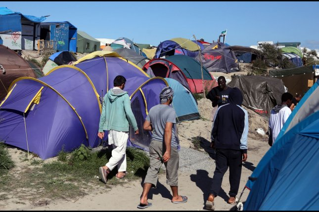 The refugee camp in Calais, France, known as The Jungle, will start to be cleared of people and torn down this week, French officials say. Tents and shelters have piled in the illegal makeshift camp, which now contains about 6,900 people, 1,200 of whom are children. The migrants will be given the option of returning to their home country or filing for asylum in France in one of two locations. File photo by Maya Vidon-White/UPI