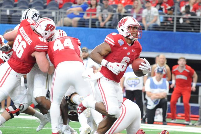Former Wisconsin Badgers running back Corey Clement scores on a 2-yard run against the Western Michigan Broncos in the first quarter of the 2017 Cotton Bowl in Arlington, Texas on January 2, 2017. Clement has been impressive with his new team, the Philadelphia Eagles. File photo by Ian Halperin/UPI